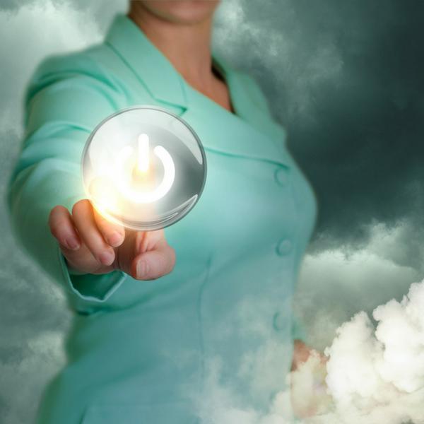 Women pressing glowing power button