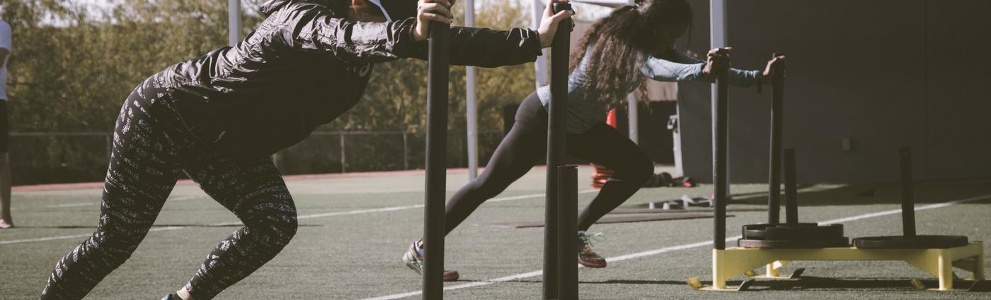 Women pushing weights